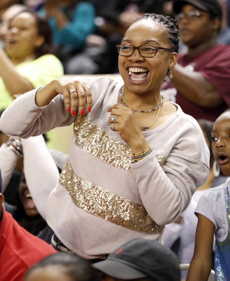 Northeast fan Jeanna Washington cheer during the 2A girls championship game where the Northeast Academy Lady Vikings defeated the Alva high school Lady Bugs 53-36 at the State Fair Arena on Saturday, March 9, 2013 in Oklahoma City, Okla.  Photo by Steve Sisney, The Oklahoman