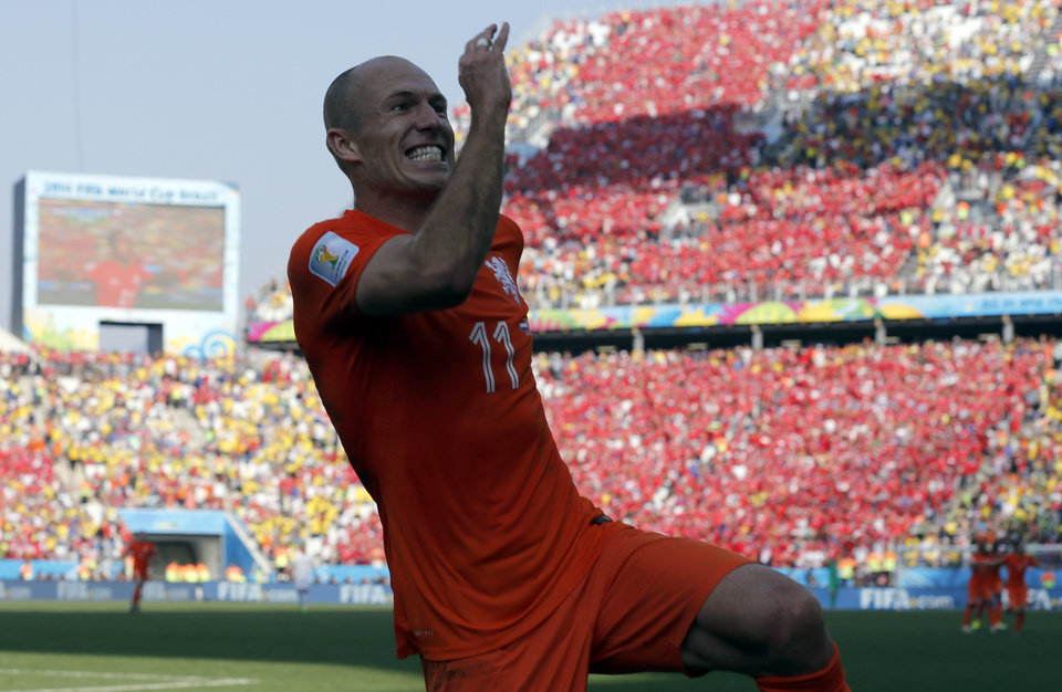 Photo - Netherlands' Arjen Robben after his teammate Memphis Depay scored their second goal during the group B World Cup soccer match between the Netherlands and Chile at the Itaquerao Stadium in Sao Paulo, Brazil, Monday, June 23, 2014. The Dutch team beat Chile 2-0 to top Group B. (AP Photo/Frank Augstein)