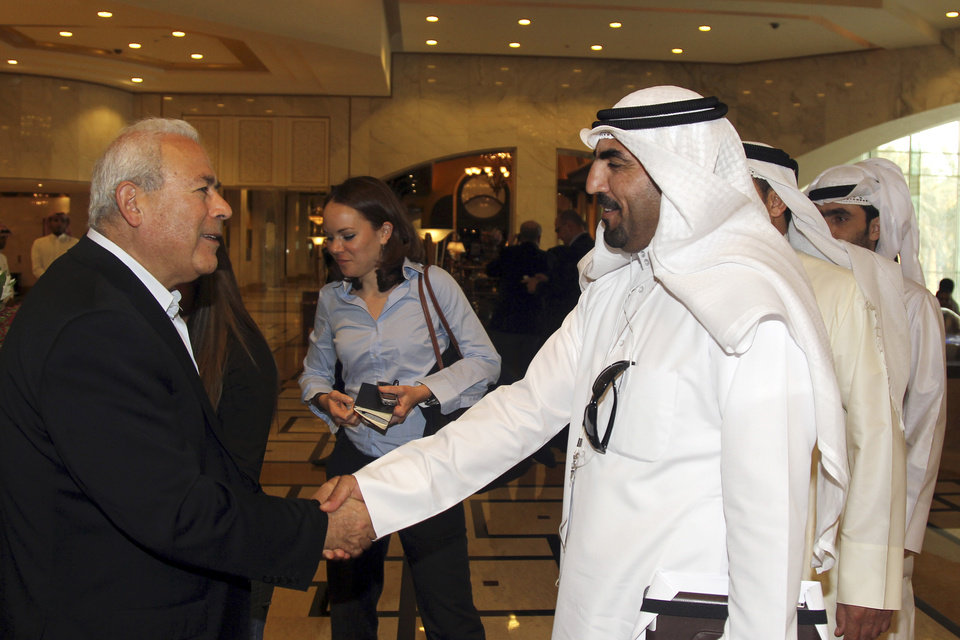 Photo -   Burhan Ghalioun, leader of the opposition Syrian National Council (SNC), left, shakes hands with one of the attendees during the meeting of the General Assembly of the Syrian National Council in Doha, Qatar, Sunday, Nov. 4, 2012. A plan to shake up Syria's widely criticized opposition leadership and forge a more representative team has won the backing of several key countries, the proposal's author said Sunday, even as other anti-regime groups pushed back against the idea. (AP Photo/Osama Faisal)