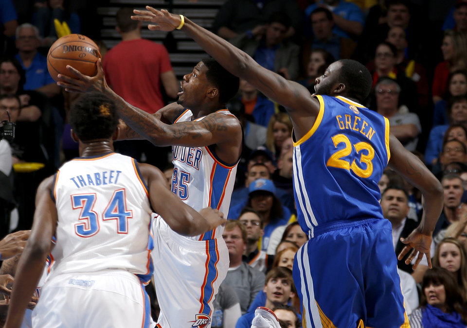 Oklahoma City\'s DeAndre Liggins (25) got past Golden State\'s Draymond Green (23) during an NBA basketball game between the Oklahoma City Thunder and the Golden State Warriors at Chesapeake Energy Arena in Oklahoma City, Wednesday, Feb. 6, 2013. Photo by Bryan Terry, The Oklahoman