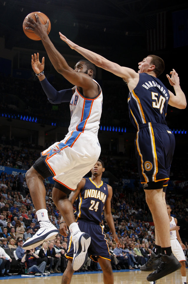Photo - Oklahoma City's James Harden (13) goes past Indiana's Tyler Hansbrough (50) during the NBA basketball game between the Oklahoma City Thunder and the Indiana Pacers at the Oklahoma City Arena, Wednesday, March 2, 2011. Photo by Bryan Terry, The Oklahoman