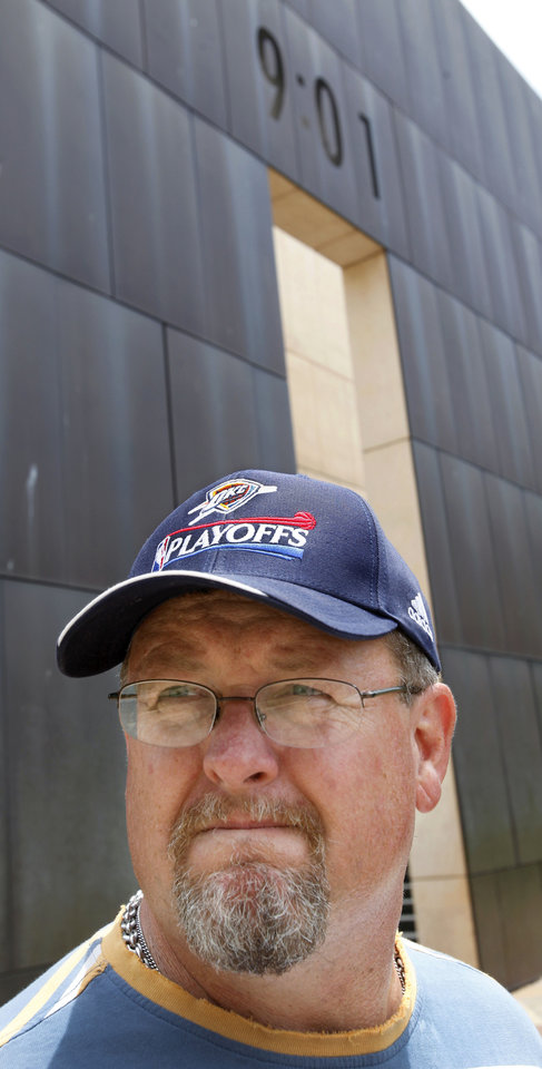 Photo - Brent Sullivan wears a Thunder cap while visiting the Oklahoma City National Memorial &  Museum Saturday afternoon, June 16,  2012.  Sullivan, his wife and three daughters who live in Springfield, MO.,  made the trip to Oklahoma City and included the Memorial on their list of places to visit.   Sullivan  became a fan of the Oklahoma City Thunder earlier this season after watching their games on television. He said he received the hat from a daughter  as an early Father's Day gift.  Sullivan and his family all agreed they would cheering for Thunder wins during the NBA Finals against the Miami Heat. Photo by Jim Beckel, The Oklahoman