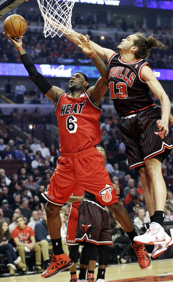 Miami Heat forward LeBron James (6) drives to the basket against Chicago Bulls center Joakim Noah during the first half of an NBA basketball game in Chicago, Thursday, Feb. 21, 2013. (AP Photo/Nam Y. Huh)