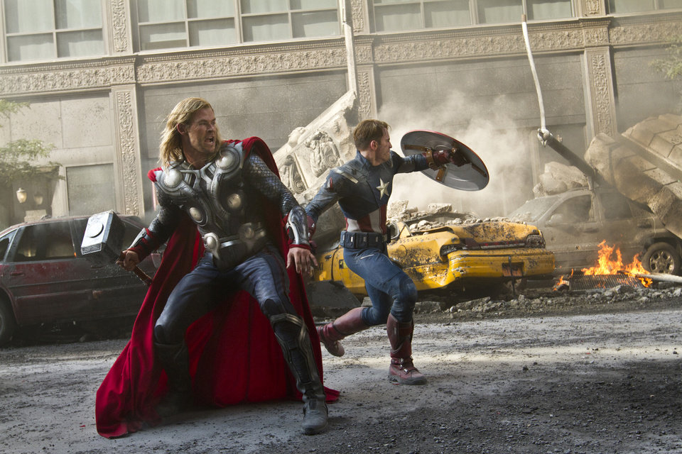 Photo -   In this film image released by Disney, Chris Hemsworth portrays Thor, left, and and Chris Evans portrays Captain America in a scene from