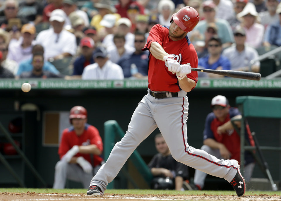 Washington Nationals' Bryce Harper hits a two-run double during the third inning of an exhibition spring training baseball game against the Miami Marlins, Wednesday, March 20, 2013, in Jupiter, Fla. The Nationals won 7-5. (AP Photo/Jeff Roberson)