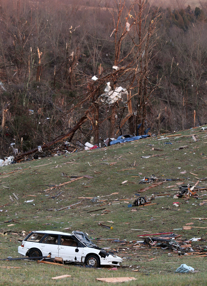 A car was blown several hundred feet from a home into a field Friday, March 2, 2012 in Boone County, Ky. Powerful storms stretching from the Gulf Coast to the Great Lakes flattened buildings in several states, wrecked two Indiana towns and bred anxiety across a wide swath of the country in the second powerful tornado outbreak this week.  (AP Photo/The Cincinnati Enquirer, Patrick Reddy) MANDATORY CREDIT;  NO SALES   ORG XMIT: OHCIN102