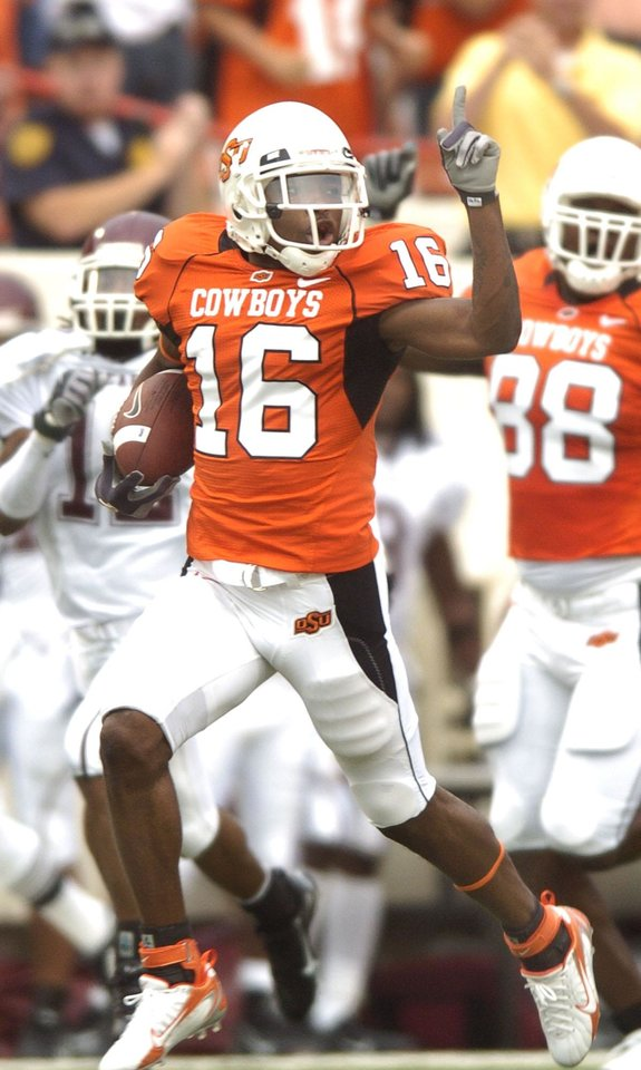 Photo - Perrish Cox raises a finger at the end of his opening kickoff return for a TD during the college football game between Oklahoma State University (OSU) Cowboys and Missouri State University (MSU) Bears at Boone Pickens Stadium in Stillwater, Okla. Saturday September 2, 2006. BY MATT STRASEN, THE OKLAHOMAN. ORG XMIT: KOD