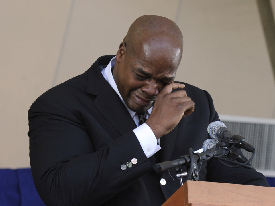 Photo - National Baseball Hall of Fame inductee Frank Thomas wipes away tears as he speaks during an induction ceremony at the Clark Sports Center on Sunday, July 27, 2014, in Cooperstown, N.Y. (AP Photo/Tim Roske)