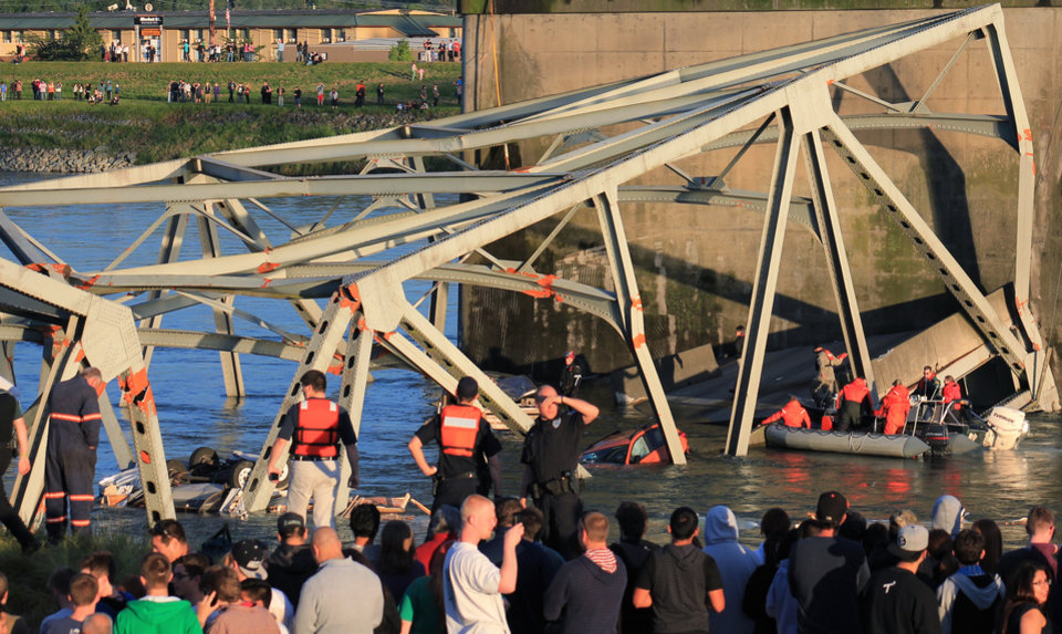 Photo - In this photo provided by Francisco Rodriguez, rescue workers surround the scene where a pickup truck and a car fell into the Skagit River after the collapse of the Interstate 5 bridgeThursday, May 23, 2013, in Mount Vernon, Wash. (AP Photo/Francisco Rodriguez)