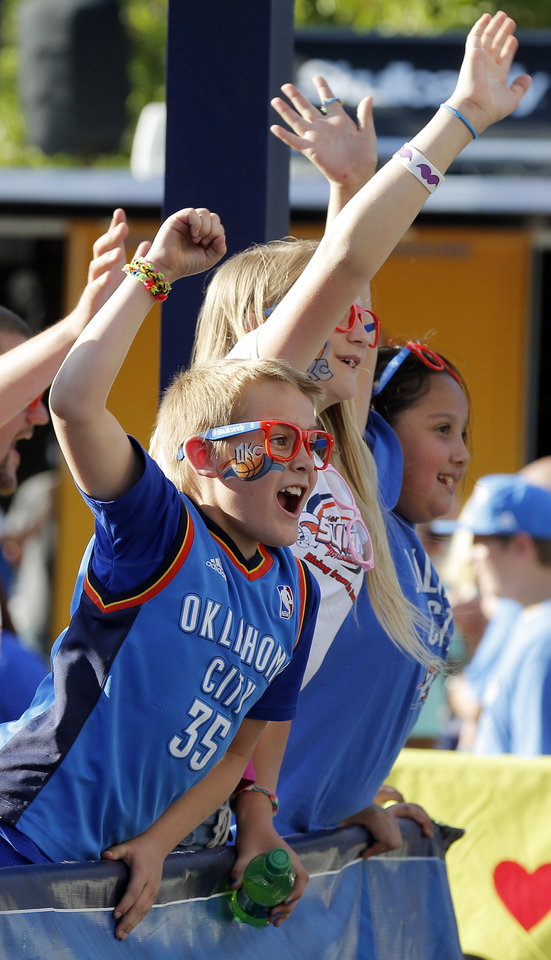 Photo - Fans cheer during the pre-game broadcast in Thunder Alley before Game 7 in the first round of the NBA playoffs between the Oklahoma City Thunder and the Memphis Grizzlies at Chesapeake Energy Arena in Oklahoma City, Saturday, May 3, 2014. Photo by Nate Billings, The Oklahoman