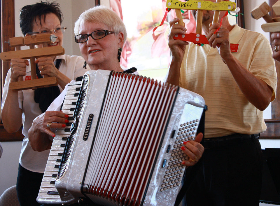 Photo - Barbara Duer takes a turn with an accordion on Sunday at the Santa Fe Depot in Norman. More than 20 accordionists performed at the event sponsored by the Oklahoma Accordion Club. PHOTO BY LYNETTE LOBBAN, FOR THE OKLAHOMAN