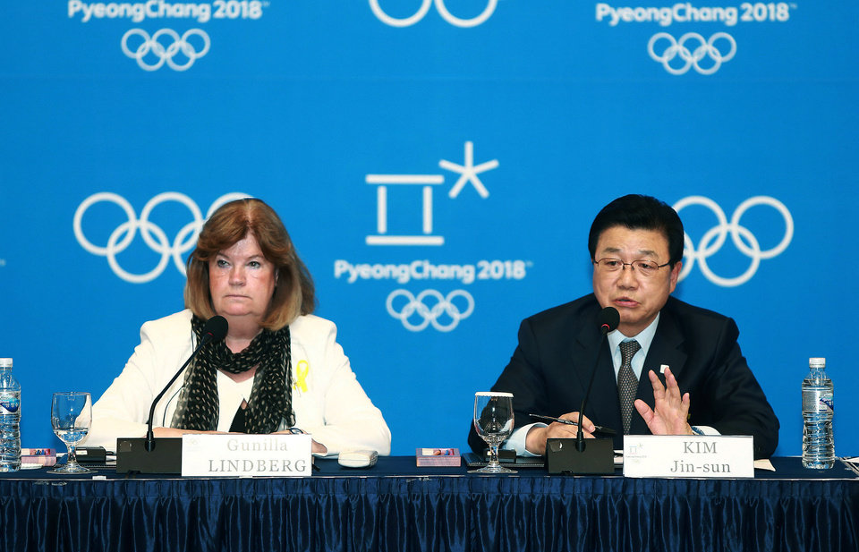 Photo - Kim Jin-sun, head of the Pyeongchang Organizing Committee for the 2018 Winter Olympic Games, right, speaks during a press conference as Gunilla Lindberg, chair of the IOC Evaluation Commission, listens in Pyeongchang, South Korea, Thursday, May 1, 2014. The IOC is convinced that preparations for the 2018 Winter Games in Pyeongchang are on track, in contrast with concerns over the chronic construction delays for the 2016 Olympics in Rio de Janeiro.(AP Photo/Yonhap)  KOREA OUT