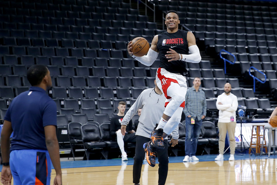Photo - Houston's Russell Westbrook warms up before an NBA basketball game between the Oklahoma City Thunder and Houston Rockets at Chesapeake Energy Arena in Oklahoma City, Thursday, Jan. 9, 2020. [Bryan Terry/The Oklahoman]