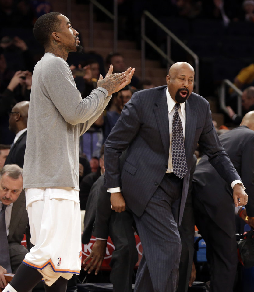 Photo - New York Knicks coach Mike Woodson, right, and guard J.R. Smith, celebrate after the Knicks' 115-94 victory over the Milwaukee Bucks in an NBA basketball game at New York's Madison Square Garden, Saturday, March 15, 2014. (AP Photo/Richard Drew)