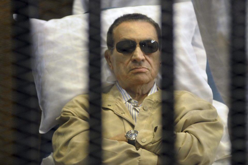 FILE - In this Saturday, June 2, 2012 file photo, Egypt\'s ex-President Hosni Mubarak lays on a gurney inside a barred cage in the police academy courthouse in Cairo, Egypt. An Egyptian appeals court on Sunday overturned Hosni Mubarak\'s life sentence and ordered a retrial of the ousted leader in the killing of hundreds of protesters, a ruling likely to further unsettle a nation still reeling from political turmoil and complicate the struggle of his Islamist successor to assert his authority. (AP Photo, File)