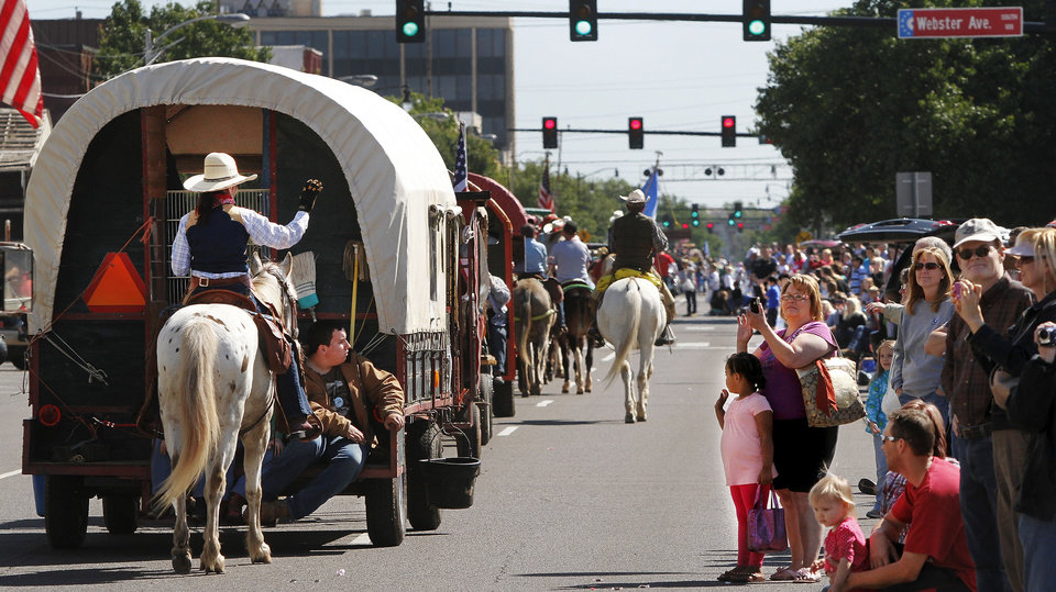 A wagon train makes its way down Main Street during last year�s 89er Day Parade in Norman. OKLAHOMAN ARCHIVE PHOTO