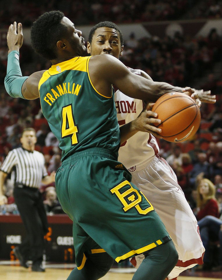 Photo - Oklahoma's Je'lon Hornbeak (5) tries to get past Baylor's Gary Franklin (4) during an NCAA men's college basketball game between Baylor and the University of Oklahoma (OU) at Lloyd Noble Center in Norman, Okla., Saturday, Feb. 8, 2014. Photo by Nate Billings, The Oklahoman