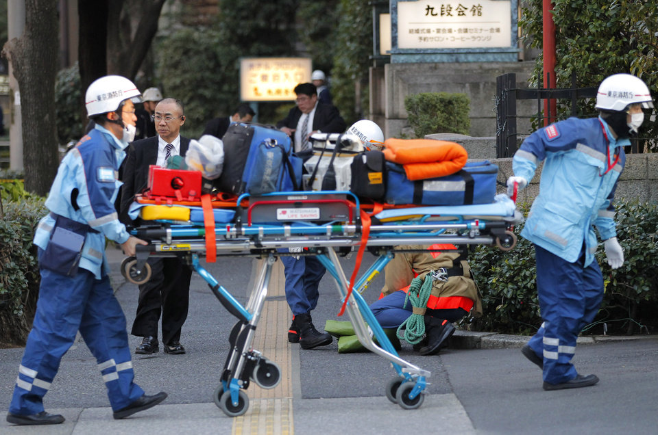 Photo - Tokyo Fire Department rescue workers arrive at Kudan Kaikan in Tokyo as local media said part of its ceiling fell down after a strong earthquake, injuring people inside the hall Friday, March 11, 2011. (AP Photo/Itsuo Inouye) ORG XMIT: XITS107