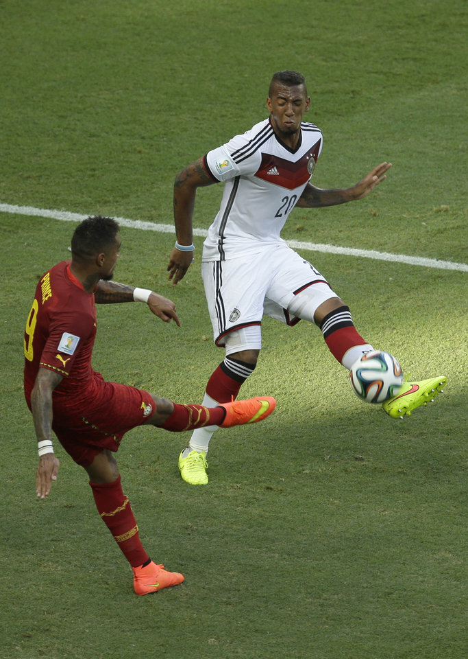 Photo - Germany's Jerome Boateng, right, blocks a shot by his half-borther Ghana's Kevin-Prince Boateng during the group G World Cup soccer match between Germany and Ghana at the Arena Castelao in Fortaleza, Brazil, Saturday, June 21, 2014. (AP Photo/Themba Hadebe)