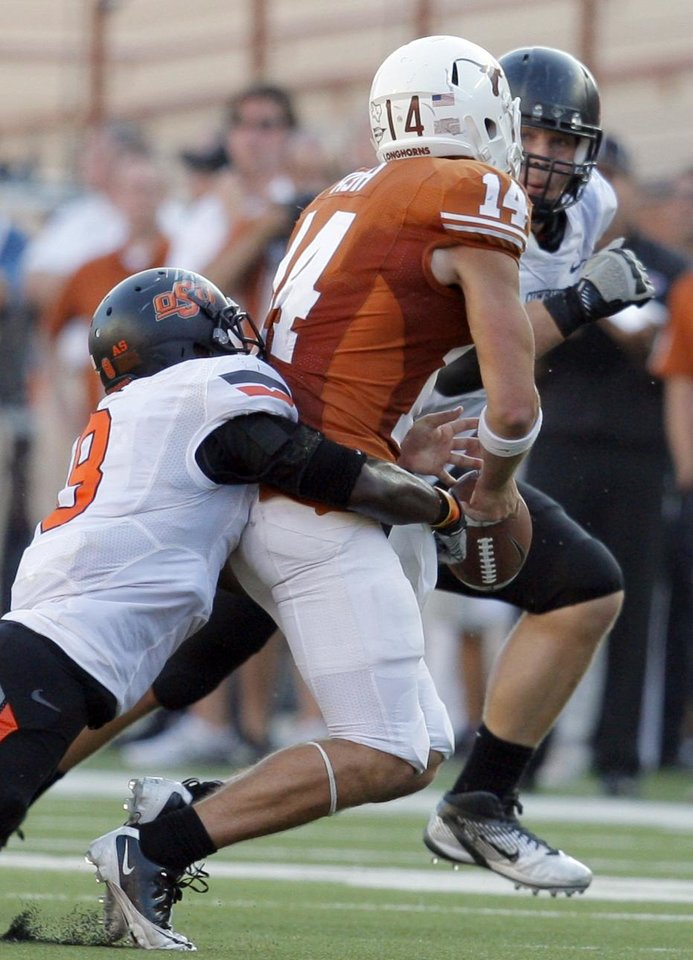 Photo - Oklahoma State's Daytawion Lowe (8) forces Texas' David Ash (14) to fumble in the fourth quarter of a college football game between the Oklahoma State University Cowboys (OSU) and the University of Texas Longhorns (UT) at Darrell K Royal-Texas Memorial Stadium in Austin, Texas, Saturday, Oct. 15, 2011. Photo by Sarah Phipps, The Oklahoman
