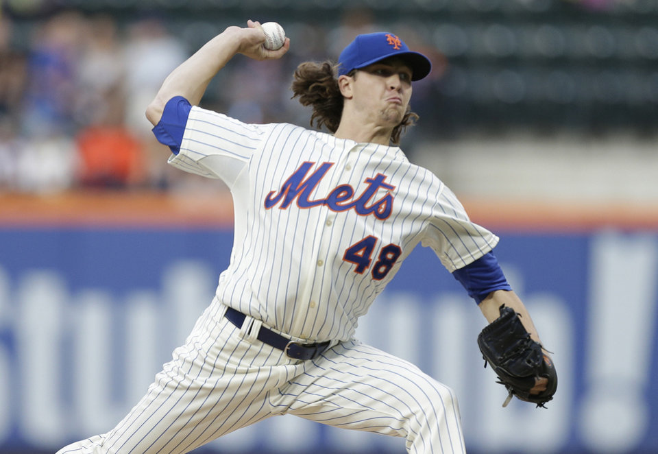 Photo - New York Mets' Jacob deGrom delivers a pitch during the first inning of a baseball game against the San Francisco Giants on Saturday, Aug. 2, 2014, in New York. (AP Photo/Frank Franklin II)