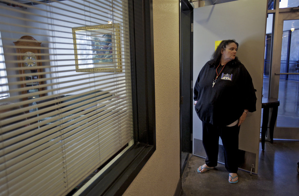 City Rescue Mission resident Jill Thompson waits outside the door to speak with the shelter\'s director of bridge to life women\'s program Brenda Guisinger on Thursday, Nov. 17, 2011. in Oklahoma City, Okla. Thompson works the B.T.L program to help in the recovery of physical and substance abuse that played a major role in her homeless situation. Photo by Chris Landsberger, The Oklahoman