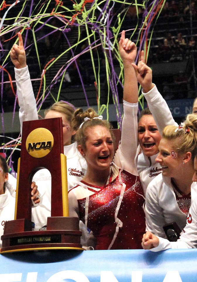 Photo - Oklahoma celebrates after being crowned co-champions with Florida during the NCAA college women's gymnastics championships on Saturday, April 19, 2014, in Birmingham, Ala. (AP Photo/Butch Dill)