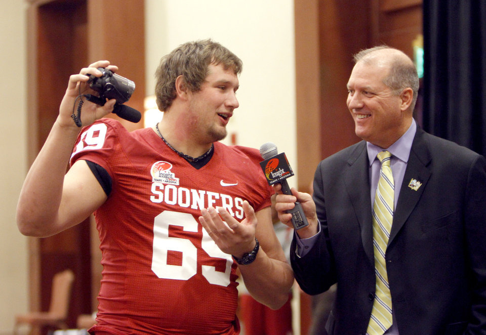 OU / COLLEGE FOOTBALL: Oklahoma Sooners' Lane Johnson records himself as he interviewed by Brad Cesmat during a University of Oklahoma media day for the Insight Bowl at the Camelback Inn in Paradise Valley, Ariz.,  Wednesday, Dec. 28, 2011. Photo by Sarah Phipps, The Oklahoman