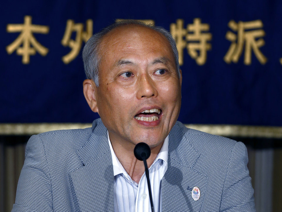 Photo - Tokyo Gov. Yoichi Masuzoe speaks during a press conference at the Foreign Correspondents' Club of Japan in Tokyo Wednesday, July 30, 2014. Masuzoe has defended his call for a review of the venue plan for the Tokyo 2020 Olympics, even if it threatens the proposal of having almost all the facilities close to the Athlete's Village. Tokyo won the right to host the 2020 Olympics with a promise to deliver a compact games with 28 of the proposed 33 competition venues within 5 miles (8 kilometers) of the village. (AP Photo/Shizuo Kambayashi)