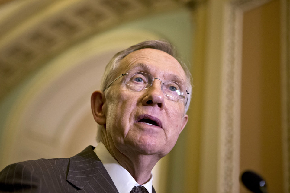 Senate Majority Leader Harry Reid of Nev. speaks with reporters on Capitol Hill in Washington, Tuesday, Dec. 11, 2012, following a Democratic strategy session. (AP Photo/J. Scott Applewhite)