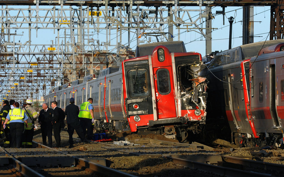 Photo - FILE - In this May 17, 2013 file photo, emergency workers arrive at the scene of a train collision  in Fairfield, Conn, after two Metro-North commuter trains serving New York City collided during Friday's evening rush hour. According to a Federal Railroad Administration review prompted by another accident on Dec. 1, 2013 that killed four passengers and injured about 70 others, the Metro-North commuter railroad has allowed its emphasis on trains' on-time performance to