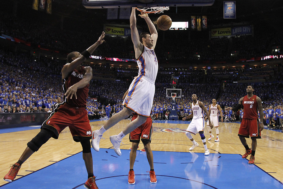 Oklahoma City's Nick Collison (4) dunks the ball in the second half during Game 1 of the NBA Finals between the Oklahoma City Thunder and the Miami Heat at Chesapeake Energy Arena in Oklahoma City, Tuesday, June 12, 2012. Photo by Chris Landsberger, The Oklahoman