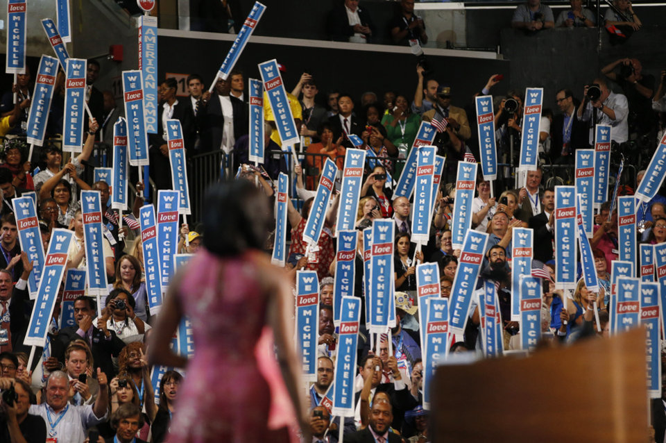 Photo - First Lady Michelle Obama waves after addressing the Democratic National Convention in Charlotte, N.C., on Monday, Sept. 3, 2012.  (AP Photo/Jae C. Hong)  ORG XMIT: DNC819