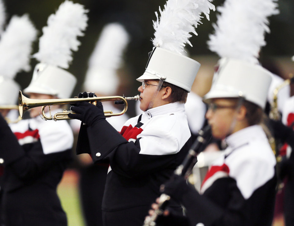 Photo - The Yukon marching band performs the national anthem before a high school football game between Norman and Yukon at Yukon High School in Yukon, Okla., Friday, Sept. 20, 2013. Photo by Nate Billings, The Oklahoman