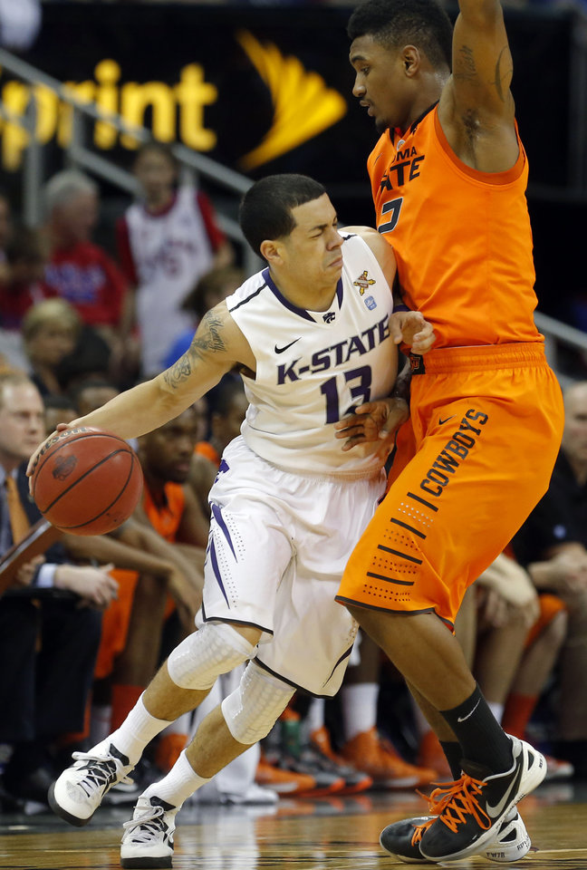 Oklahoma State\'s Le\'Bryan Nash (2) defends against Kansas State\'s Angel Rodriguez (13) during the Phillips 66 Big 12 Men\'s basketball championship tournament game between Oklahoma State University and Kansas State at the Sprint Center in Kansas City, Friday, March 15, 2013. Photo by Sarah Phipps, The Oklahoman