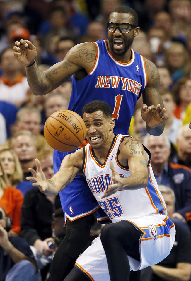 Oklahoma City's Thabo Sefolosha (25) chases a loose ball in front of New York's Amar'e Stoudemire (1) during an NBA basketball game between the New York Knicks and the Oklahoma City Thunder at Chesapeake Energy Arena in Oklahoma City, Sunday, Feb. 9, 2014. Oklahoma City won, 112-100. Photo by Nate Billings, The Oklahoman