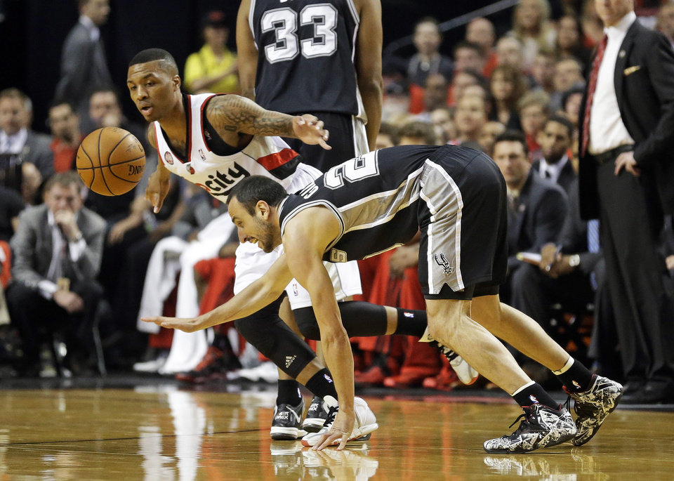 Photo - San Antonio Spurs' Manu Ginobili, right, looses the ball as Portland Trail Blazers' Damian Lillard, left, reaches for it in the first quarter during Game 4 of a Western Conference semifinal NBA basketball playoff series Monday, May 12, 2014, in Portland, Ore. (AP Photo/Rick Bowmer)