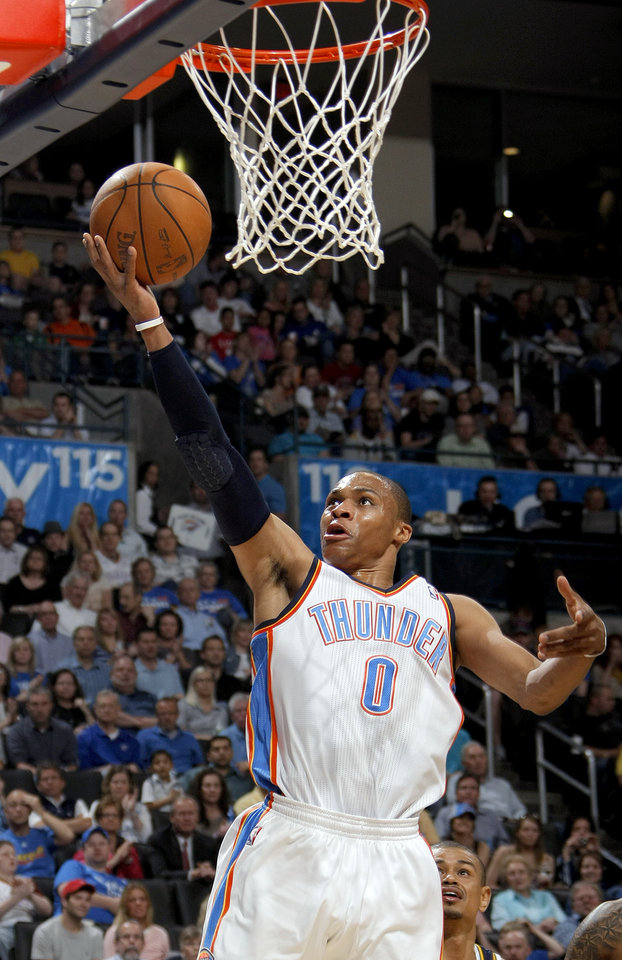 Photo - Oklahoma City's Russell Westbrook shoots a lay up during the NBA game between the Oklahoma City Thunder and Utah Jazz, Wednesday, March 23, 2011, at the Oklahoma City Arena. Photo by Sarah Phipps, The Oklahoman