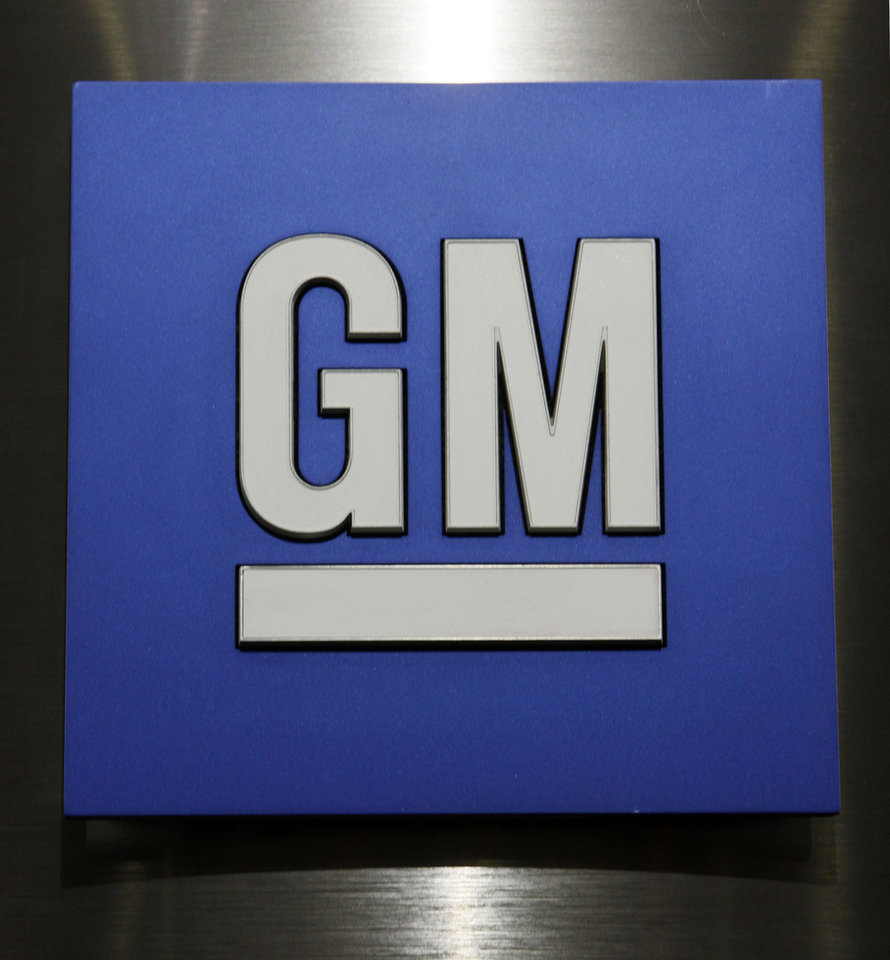 FILE - In this Jan. 25, 2010 file photo, a General Motors Co. logo is shown during a news conference in Detroit. Sunday, Nov. 18, 2012, marks the anniversary of GM\'s initial public stock offering in November 2010. The company has made money for 11 straight quarters, piling up more than $16 billion in profits. Its cars and trucks are selling for good prices. And sales are strong in China. (AP Photo/Paul Sancya, File)