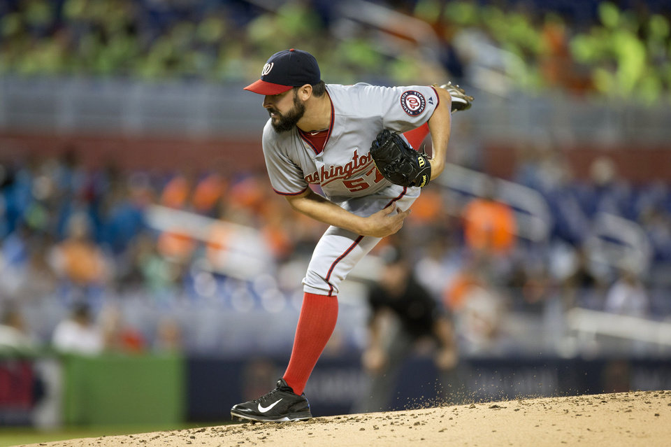Photo - Washington Nationals starter Tanner Roark pitches to the Miami Marlins during the first inning of a baseball game in Miami, Wednesday, July 30, 2014. (AP Photo/J Pat Carter)