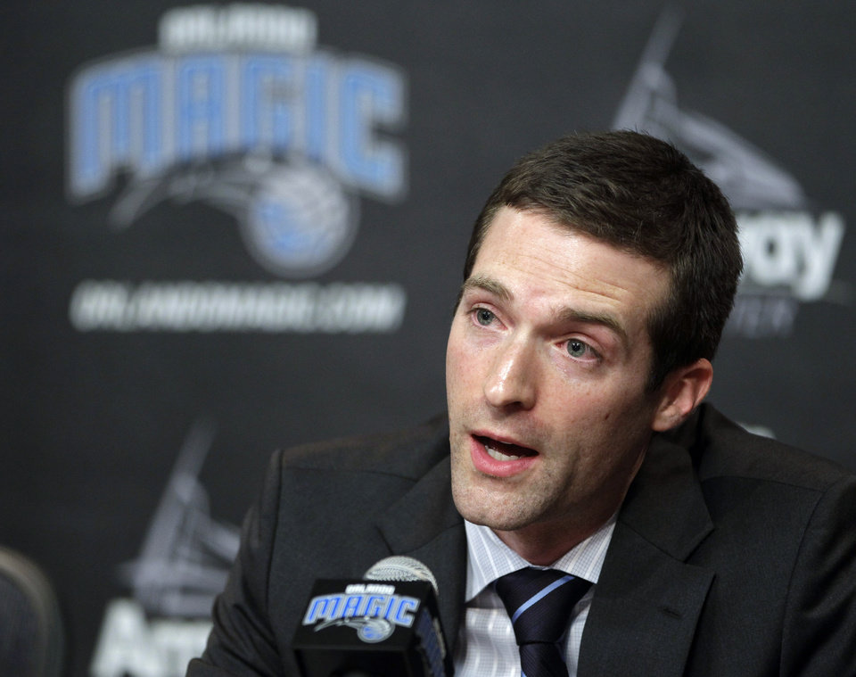 Rob Hennigan, the new general manager of the Orlando Magic NBA basketball team, speaks during a news conference, Thursday, June 21, 2012, in Orlando, Fla. (AP Photo/John Raoux)  ORG XMIT: FLJR102