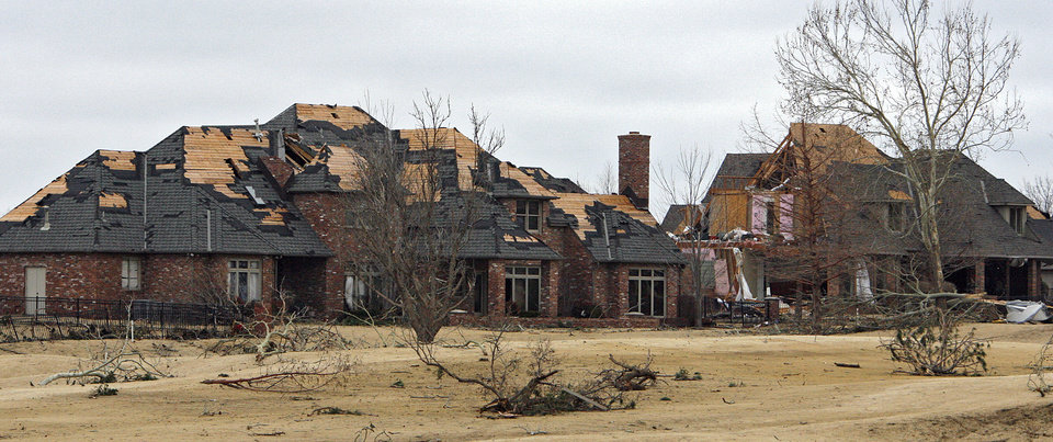 Photo - Damage to a home in the Oaktree addition on Wednesday, Feb. 11, 2009, after a tornado hit the area on Tuesday in Edmond, Okla. PHOTO BY CHRIS LANDSBERGER, THE OKLAHOMAN