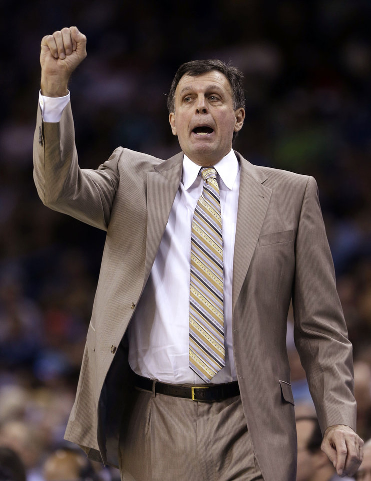 Photo - Houston Rockets head coach Kevin McHale calls out to his team in the first half of an NBA basketball game against the New Orleans Hornets in New Orleans, Friday, Jan. 25, 2013. (AP Photo/Gerald Herbert)