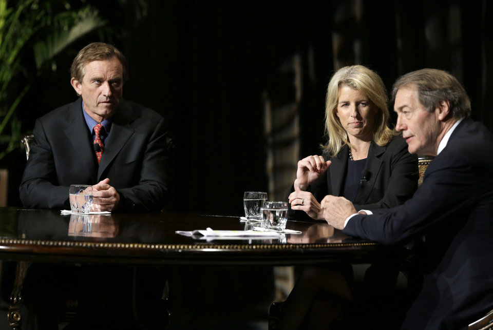 Journalist Charlie Rose, right, makes opening comments as Rory Kennedy, center, and Robert F. Kennedy Jr., left, look on before Rose conducted an interview in front of a full audience at the AT&T Performing Arts Center Friday, Jan. 11, 2013, in Dallas.  The Kennedys are in Dallas as a year of observances begins for the 50th anniversary of President John F. Kennedy's assassination. (AP Photo/Tony Gutierrez)