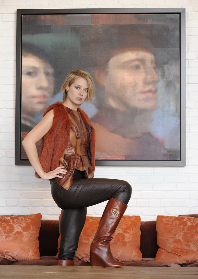 Photo - Slip on a second skin of fur or leather this season. Here, Vince leather leggings, L'Apparenza, $1,250; Ragdoll Couture leather top, Doll House Boutique, $319; Rowen wedge boots, Sassanova, $266; Janis Savitt earrings, Trillium, $78. (Lloyd Fox/Baltimore Sun/MCT)