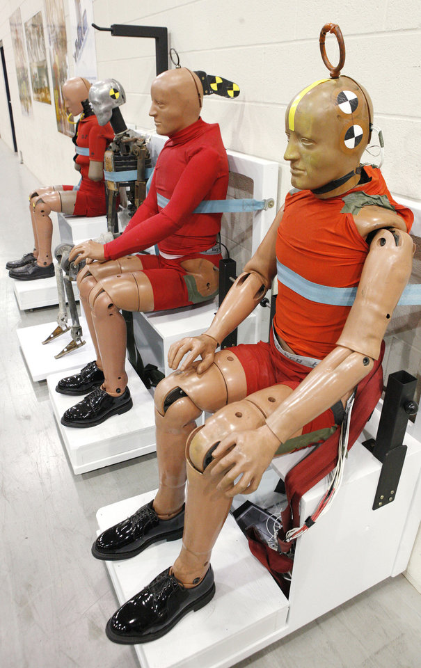 Aircraft crash test dummies wait their turn at the FAA's Civil Aerospace Medical Institute in Oklahoma City, which is celebrating 50 years.