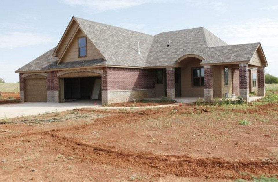 Photo - This home at 6909 NW 161 is by Steve Allen of Allenton Homes & Development.  PAUL HELLSTERN - The Oklahoman