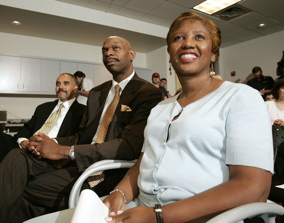 Photo - From left to right, agent Henry Thomas and parents Ron and Carolyn Brewer watch Utah Jazz pick Ronnie Brewer (not shown), of Arkansas, answer questions at a news conference Thursday, June 20, 2006, in Salt Lake City, following the NBA draft Wednesday night. Brewer is from Arkansas. (AP Photo/Douglas C. Pizac)