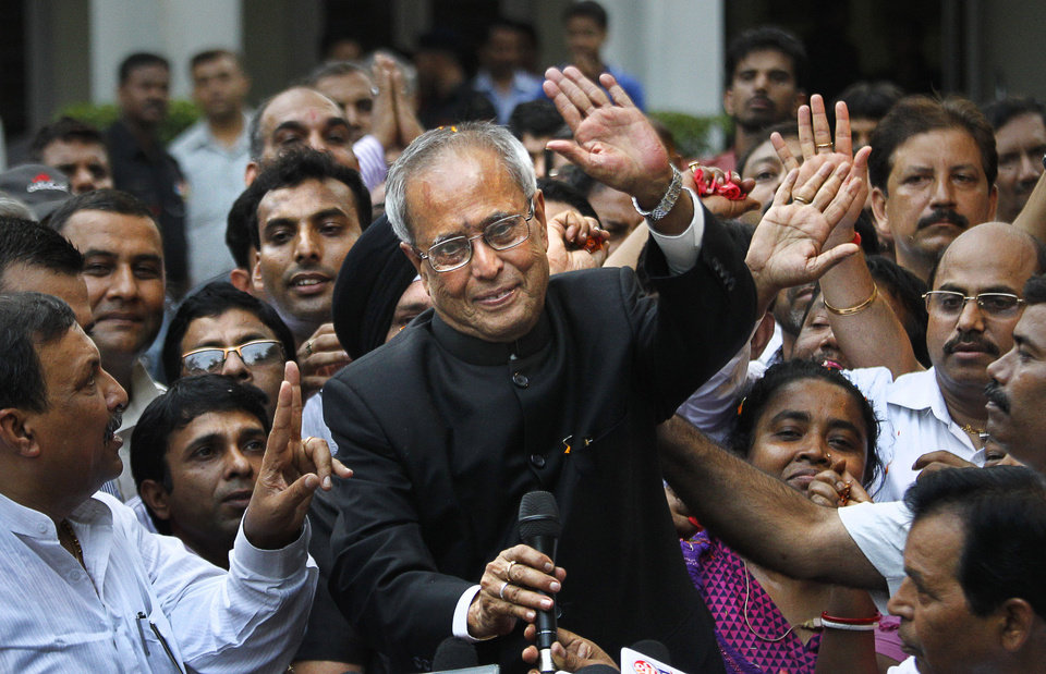 Photo -   India's president elect Pranab Mukherjee greets media outside his residence after wining in New Delhi, India, Sunday, July 22, 2012. The candidate from India's governing Congress party, former Finance Minister Mukherjee, was declared winner Sunday in the election for the country's next president, a largely ceremonial position. (AP Photo/ Manish Swarup)