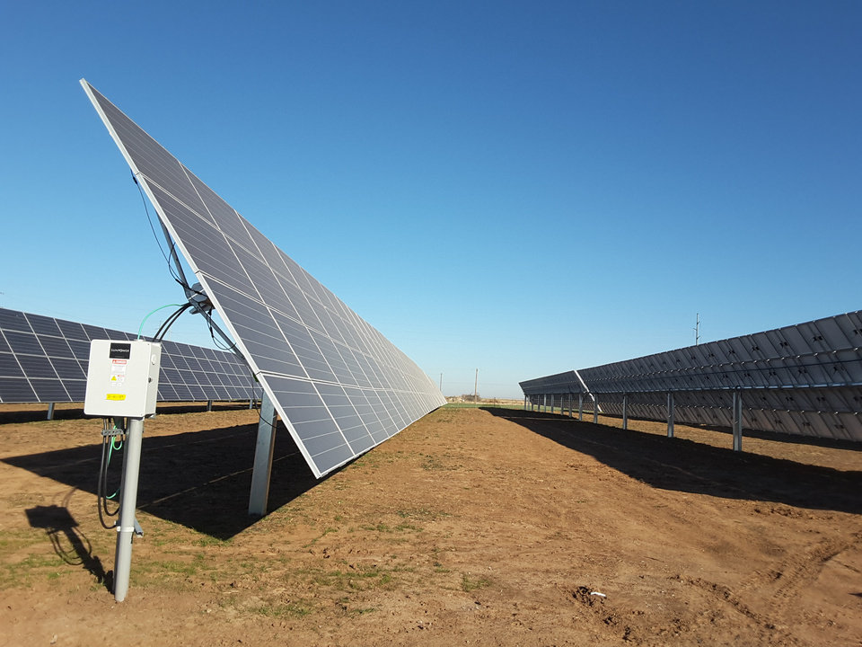 Photo -  The Covington solar generating facility features solar panels that rotate to follow the sun each day.